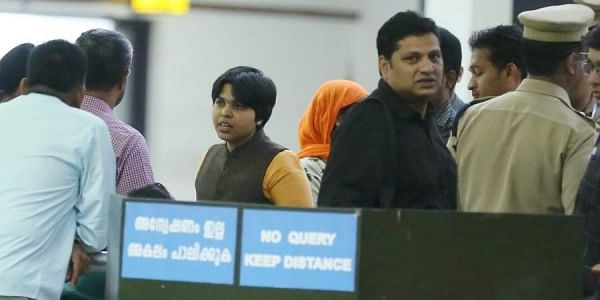 Social activist Trupti Desai (in yellow kurta) at the Kochi airport. (Photo| Special arrangement)