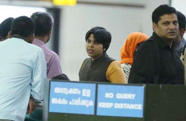 Social activist Trupti Desai (in yellow kurta) at the Kochi airport. (Photo| Special arrangement)