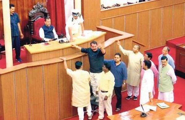 Congress members led by Opposition chief whip Taraprasad Bahinipati tried to climb up the podium of Speaker Pradip Amat | EPS
