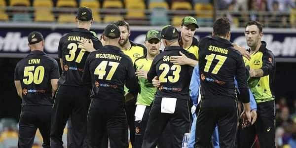 Australia players celebrate after winning the first T20 International cricket match between Australia and India in Brisbane, Australia. ( Photo| AP)
