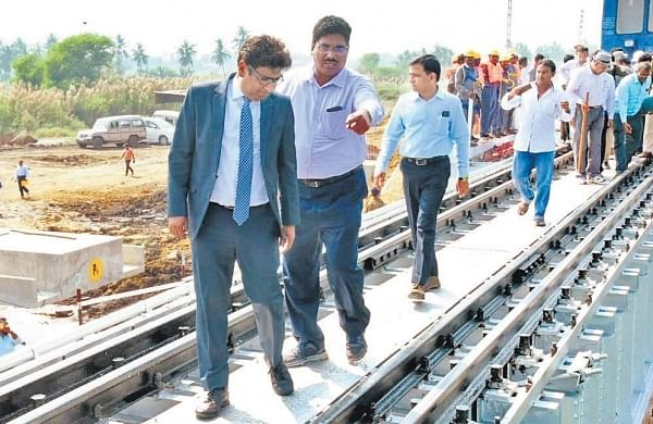 SCR General Manager Vinod Kumar Yadav inspecting a bridge between Akividu - Mandavalli section along with his team in Vijayawada division on Tuesday I Express