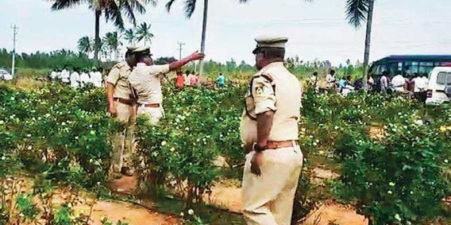 Police inspect the farm land where the body of Harish was  found | express