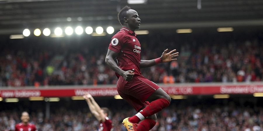 Liverpool's Sadio Mane celebrates scoring his side's second goal of the game during the Premier League match between Liverpool and West Ham United at Anfield. (Photo | AP)