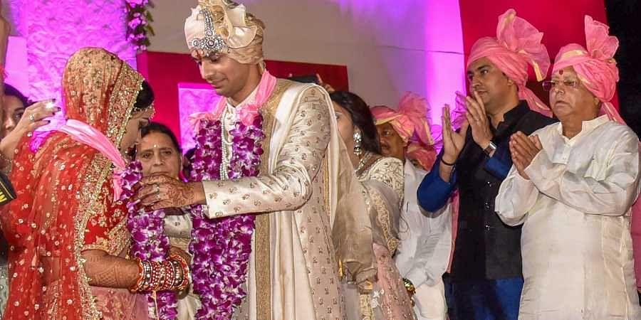 RJD chief Lalu Prasad's elder son Tej Pratap and Aishwarya Rai during their wedding ceremony at Veterinary College Ground in Patna on Saturday. (PTI)