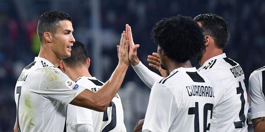 1dc448372 Coach Massimiliano Allegri hails Cristiano Ronaldo as Juventus stay ...