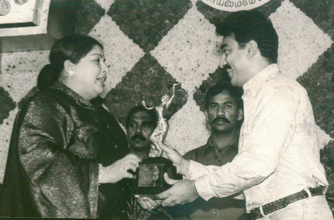 Then Tamil Nadu Chief Minister J Jayalalithaa presenting an award to actor Kamal Haasan.