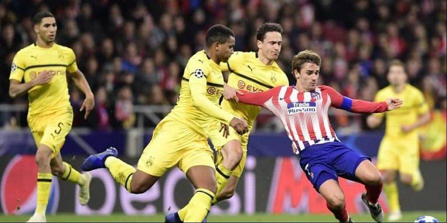 Atletico Madrid's French forward Antoine Griezmann (R) vies with Borussia Dortmund's Danish midfielder Thomas Delaney (2R) and Borussia Dortmund's Swiss defender Manuel Akanji during the UEFA Champions League group A football match between Club Atletico de Madrid and Borussia Dortmund. (Photo | AFP)