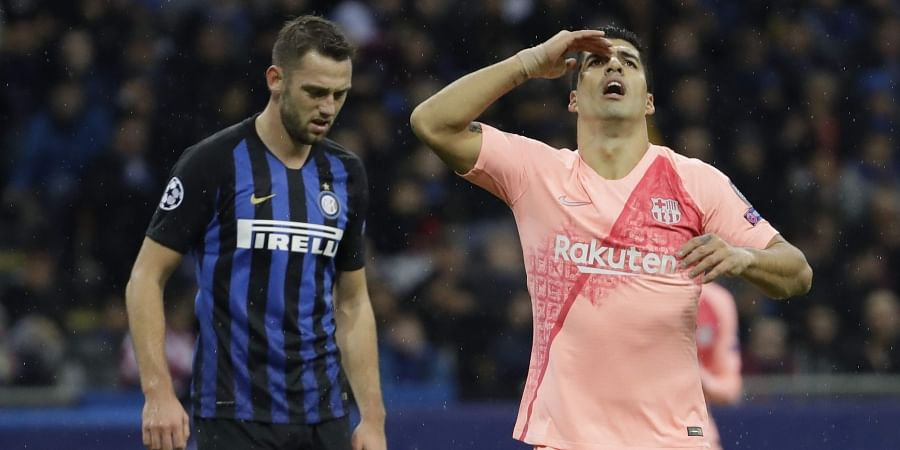 Barcelona forward Luis Suarez, right, reacts after missing a scoring chance during the Champions League group B soccer match between Inter Milan and Barcelona at the San Siro stadium in Milan, Italy. (Photo | AP)