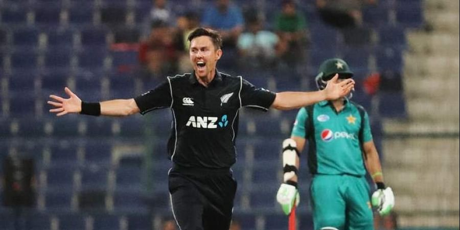 New Zealand cricketer Trent Boult (L) celebrates after he dismissed Pakistan batsman Babar Azam during the first one day international (ODI) cricket match between Pakistan and New Zealand at the Sheikh Zayed Cricket Stadium in Abu Dhabi. (Photo | AFP)
