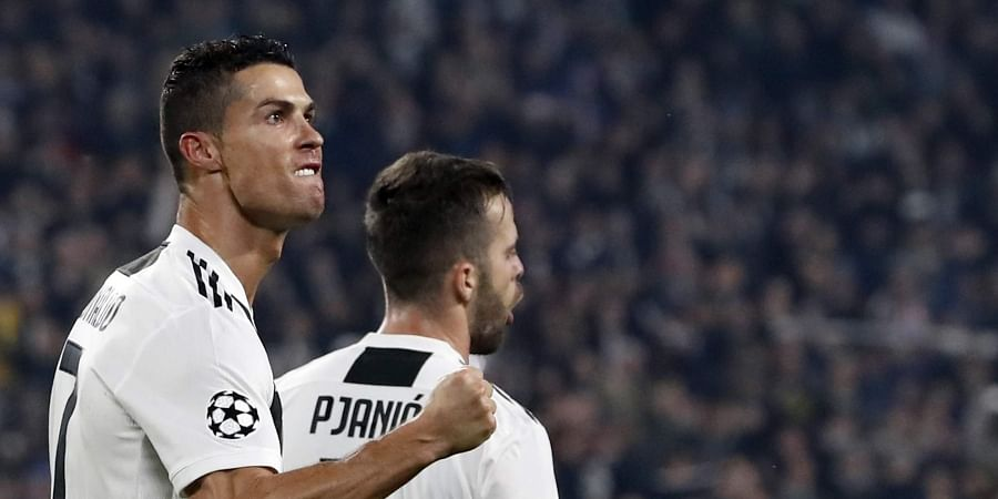Juventus forward Cristiano Ronaldo celebrates after scoring his side's opening goal during the Champions League group H soccer match between Juventus and Manchester United at the Allianz stadium in Turin, Italy. (Photo | AP)