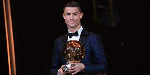 Portugese player Cristiano Ronaldo posing with the Ballon d'Or award in Paris. (File   AFP)