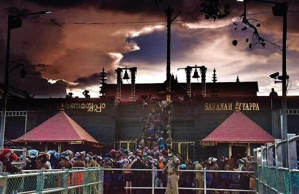 Devotees queueing up to climb the holy steps at the Lord Ayyappa temple in Sabarimala on Sunday   Vincent Pulickal