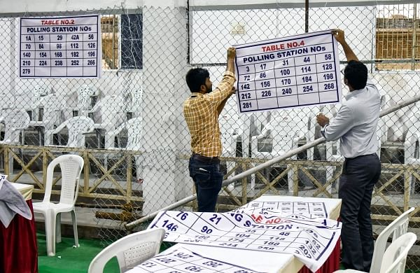 Officers on election duty making arrangements at the Amberpet GHMC ground counting center (Photo | EPS/ Vinay Madapu)