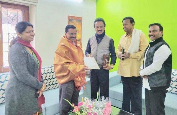M K Stalin with Arvind Kejriwal. Also in picture is Kanimozhi. (Photo: Twitter)
