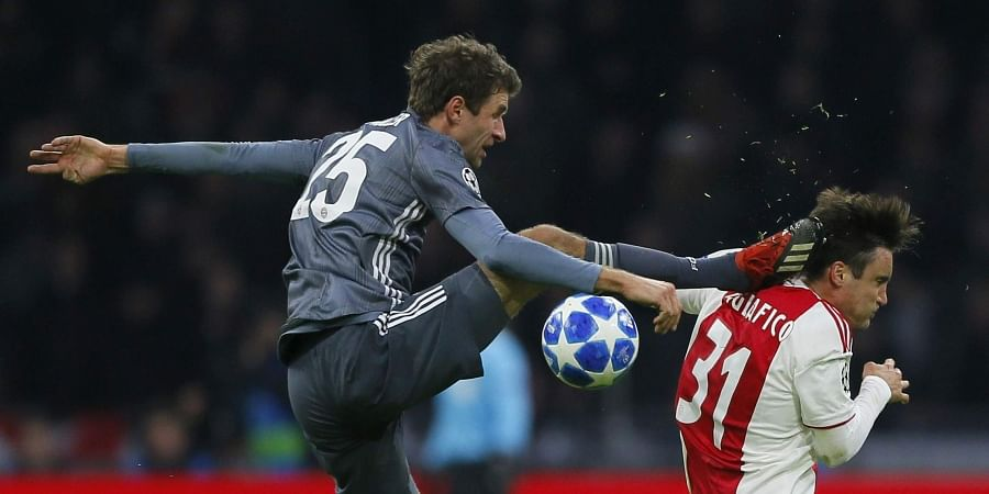 0620cf9f7 Ajax s Nicolas Tagliafico is fouled by Bayern Munich s Thomas Mueller  during their Champions League group E match (Photo