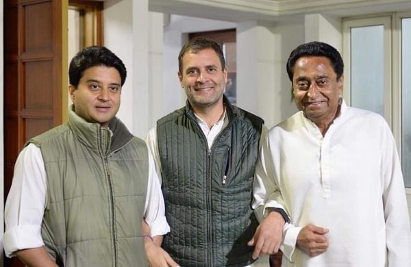 Congress chief Rahul Gandhi (in centre) with Jyotiradia Scindia on his left and Kamal Nath on his right. He used a Leo Tolstoy quote: 'The two most powerful warriors are patience and time.' (Photo   Rahul Gandhi/ Twitter)