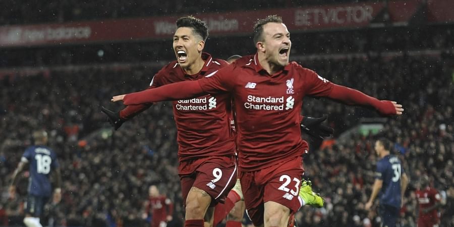 Liverpool's Xherdan Shaqiri, right, celebrates after scoring his side's third goal during the English Premier League soccer match between Liverpool and Manchester United. (Photo | AP)