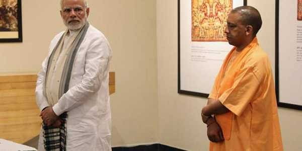 The disconnect with the people and disenchantment of its voters can be clearly seen as the BJP lost the Gorakhpur, Phulpur and Kairana parliamentary by polls. (IN PIC: PM Narendra Modi and Uttar Pradesh CM Yogi Adityanath)/AFP file photo