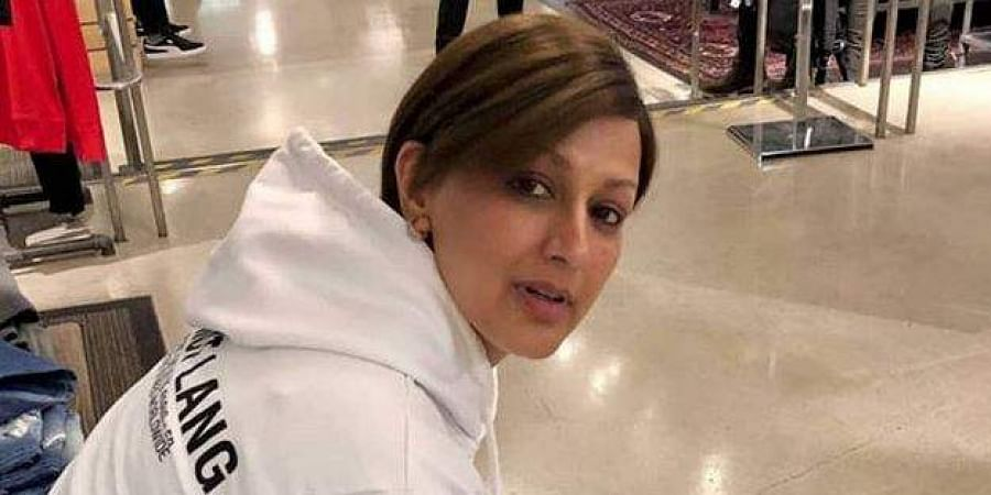 Sonali Bendre returns to Mumbai with hubby Goldie Behl""