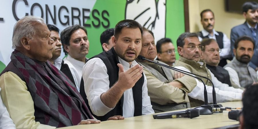 RJD's Tejashwi Yadav along with other Mahagathbandhan leaders speaks during a press conference at which RLSP leader Upendra Kushwaha joined the grand alliance at AICC in New Delhi. (Photo | PTI)