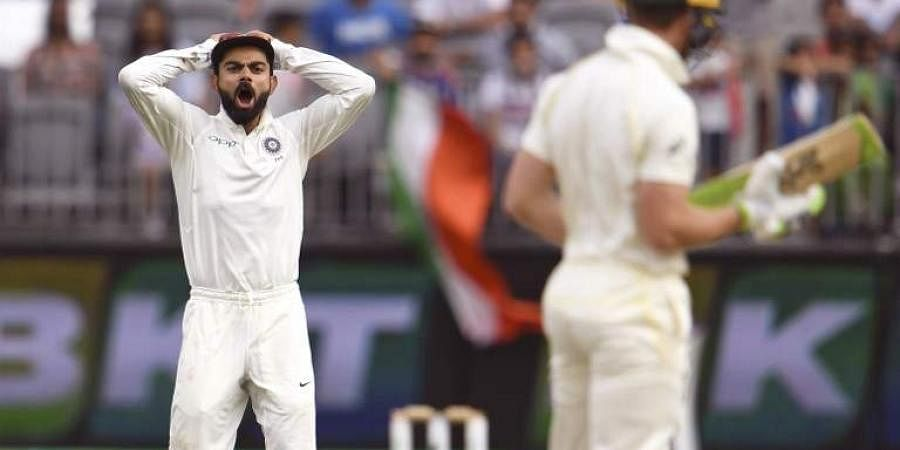 India's captain Virat Kohli (L) yells at Australia's captain Tim Paine (R) on the third day of the second cricket Test match in Perth. (Photo | AFP)