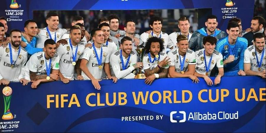 Real Madrid's players celebrate with the trophy after winning the FIFA Club World Cup final football match Spain's Real Madrid vs Abu Dhabi's Al Ain at the Zayed Sports City Stadium in Abu Dhabi. (Photo   AFP)
