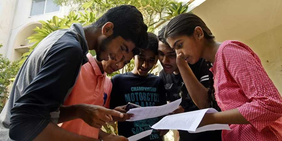 Image result for exam check students