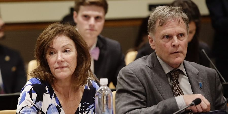 FILE - In this May 3, 2018, file photo, Fred Warmbier, right, and Cindy Warmbier, parents of Otto Warmbier, wait for a meeting at the United Nations headquarters. (Photo   AP)