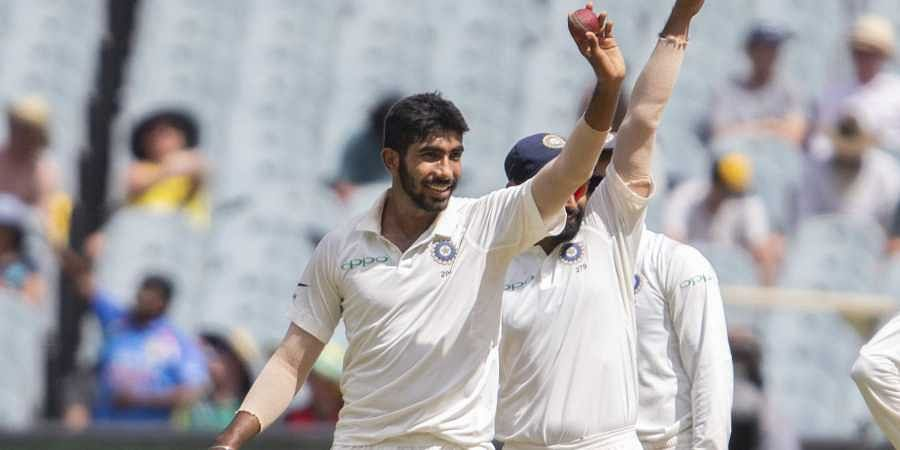 Jasprit Bumrah, left, raises the ball after getting his 5th wicket during play on day three of the third cricket test between India and Australia in Melbourne, Australia. (Photo | AP)