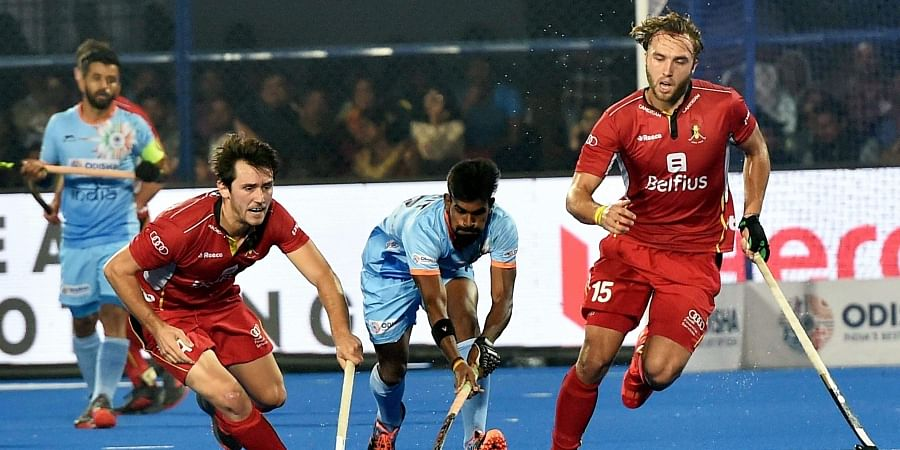 2acbe3c0464 India blue Sumit in action during a match against Belgium red Doren Van L  and Emmanuel Stockbroekx for Men s Hockey World Cup 2018 (Photo