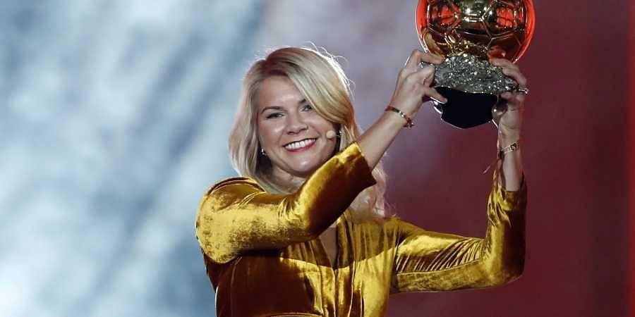 Olympique Lyonnais' Ada Hegerberg celebrates with the Women's Ballon d'Or award during the Golden Ball award ceremony at the Grand Palais in Paris on 3 December 2018. (Photo | AP)