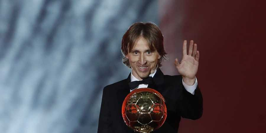 Real Madrid's Luka Modric celebrates with the Ballon d'Or award during the Golden Ball award ceremony at the Grand Palais in Paris on 3 December 2018. (Photo | AP)
