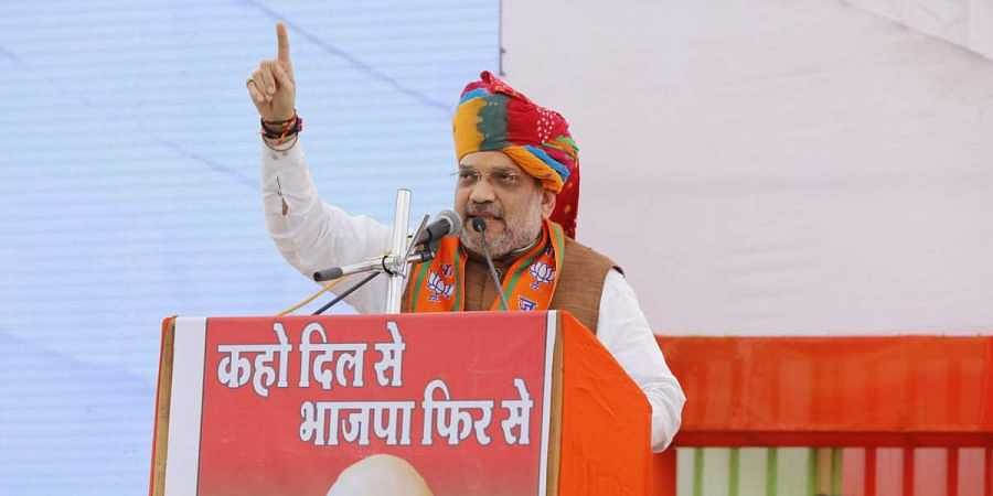 BJP chief Amit Shah at an election rally (Photo | Amit Shah/ Twitter)