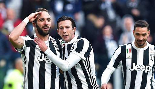 Juventus Gonzalo Higuain left celebrates with his teammate Federico Bernardeschi