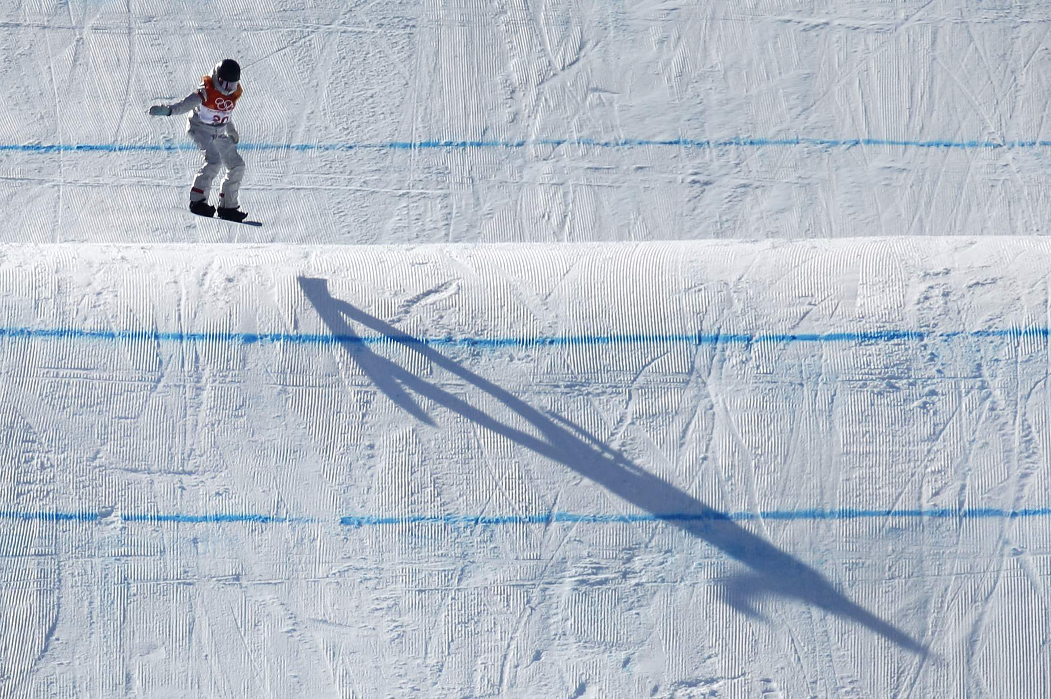 Jessika Jenson, of the United States, casts a shadow as she jumps during the women's slopestyle final at Phoenix Snow Park during the 2018 Winter Olympics in Pyeongchang. (Photo | AP)