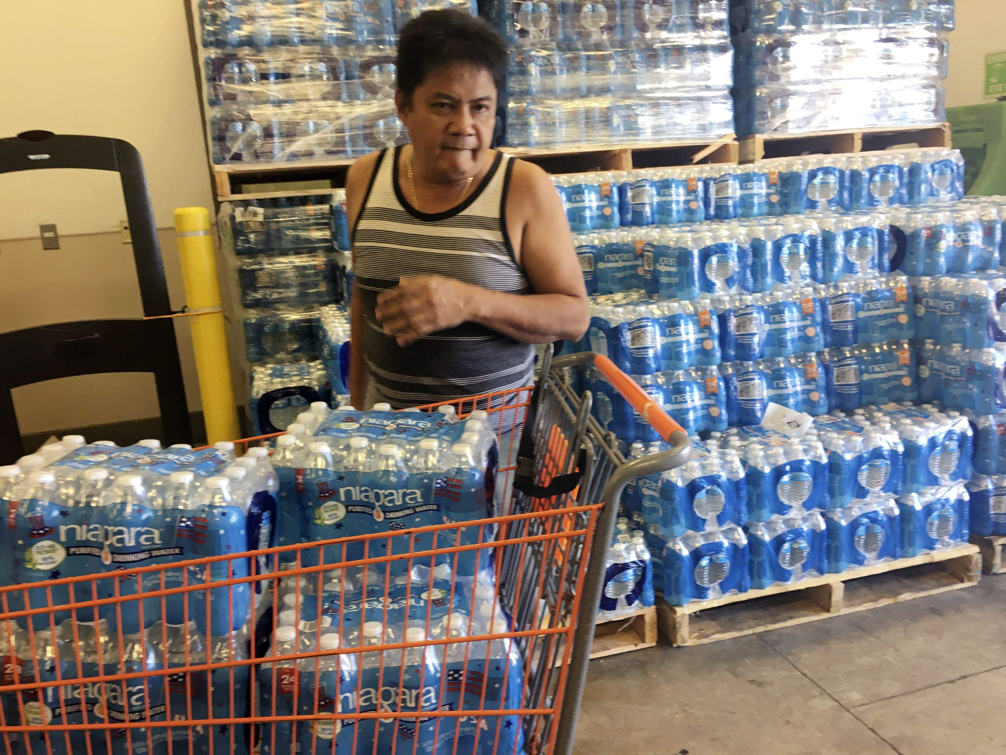 A resident buys bottles of water at Home Depot in Guam Saturday, Aug. 12, 2017.  After North Korea's nuclear threat, residents of  the small U.S. territory prepare for possible missile strike. ( Photo   AP)