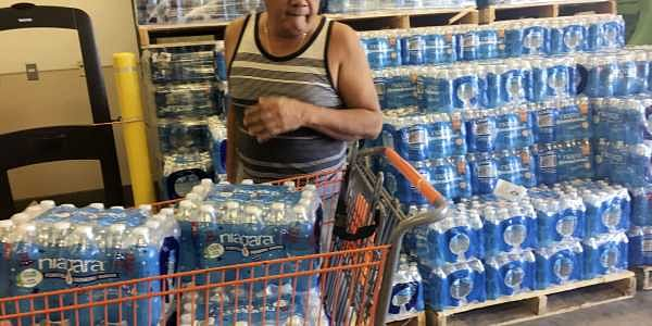A resident buys bottles of water at Home Depot in Guam Saturday, Aug. 12, 2017.  After North Korea's nuclear threat, residents of  the small U.S. territory prepare for possible missile strike. ( Photo | AP)