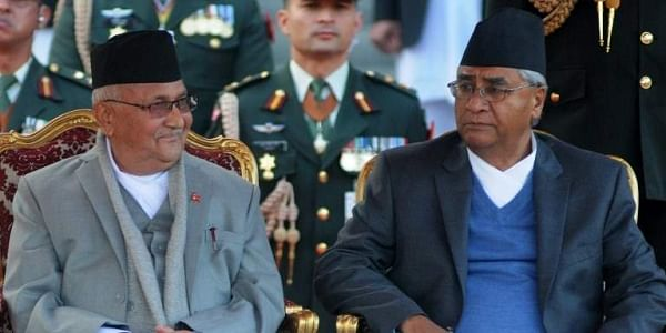 Nepal's newly-elected Prime Minister KP Sharma Oli (L) and outgoing Prime Minister Sher Bahadur Deuba (R) look on during the swearing-in ceremony at the President's House in Kathmandu. | AFP