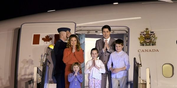 Canadian Prime Minister Justin Trudeau with his family gestures 'namaste' as he arrives at AFS Palam in New Delhi.   PTI