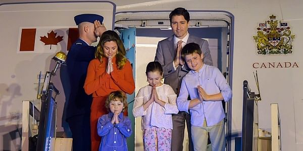 Canadian Prime Minister Justin Trudeau with his family gestures 'namaste' as he arrives at AFS Palam in New Delhi. | PTI