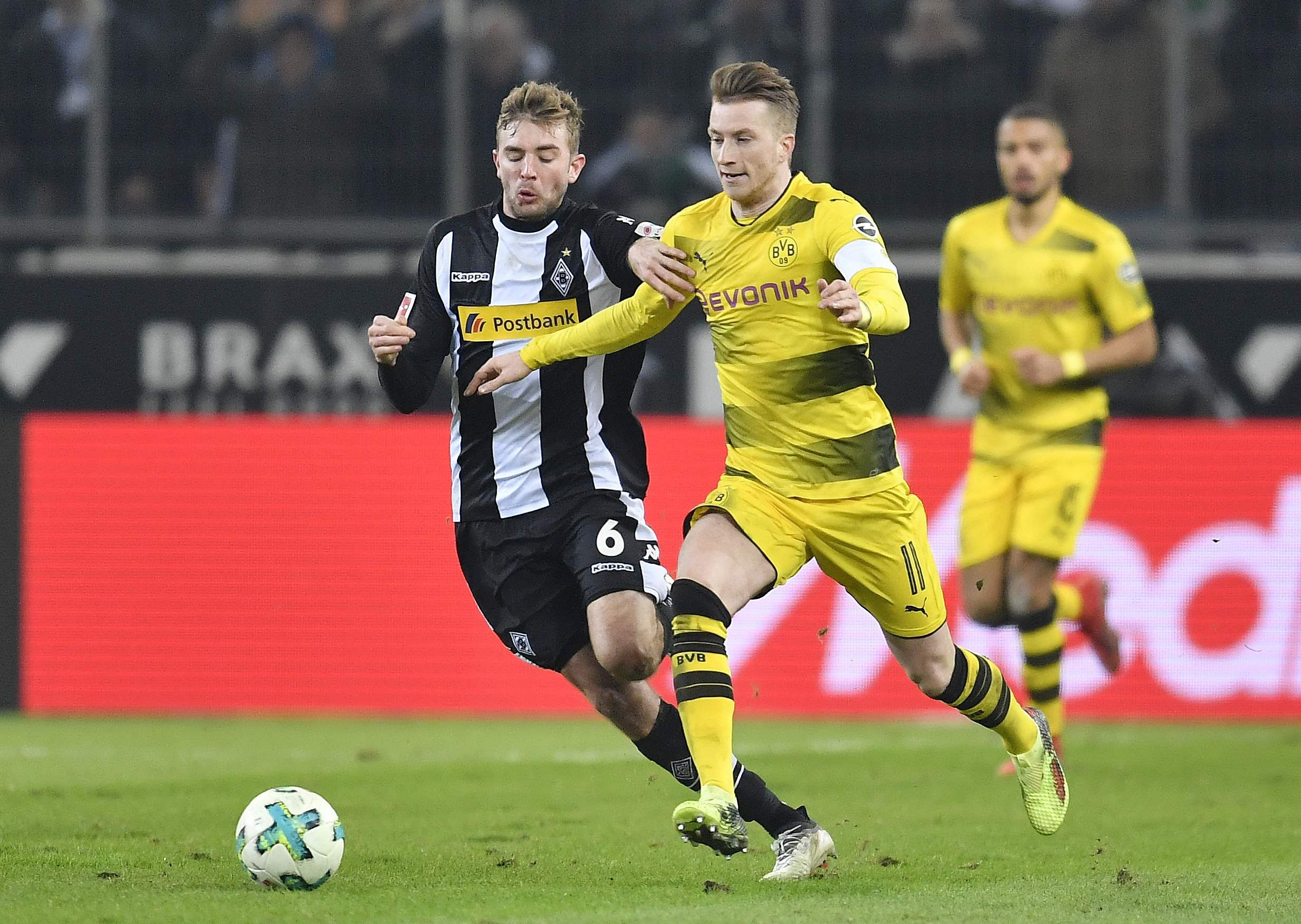 Reus gives Dortmund win with first goal since injury return