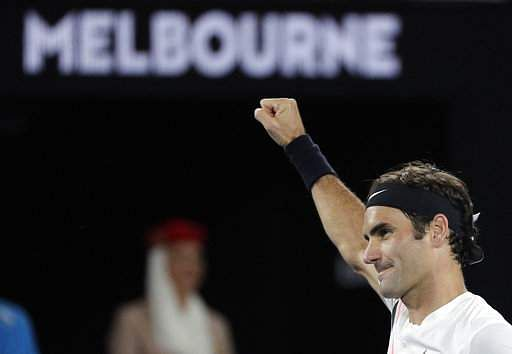 Federer brushes aside Dimitrov in under an hour to take 97th title