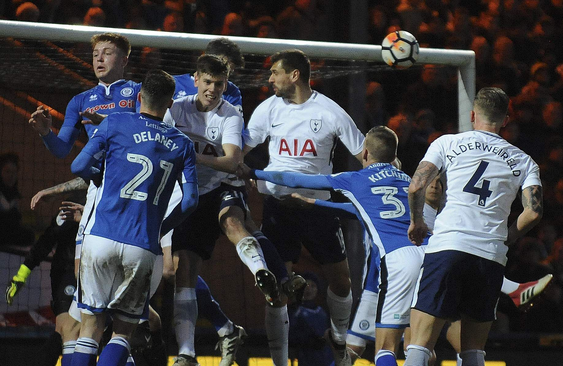 Rochdale's Mark Kitching, second from right, heads the ball during the match between Rochdale AFC and Tottenham Hotspur. (AP)