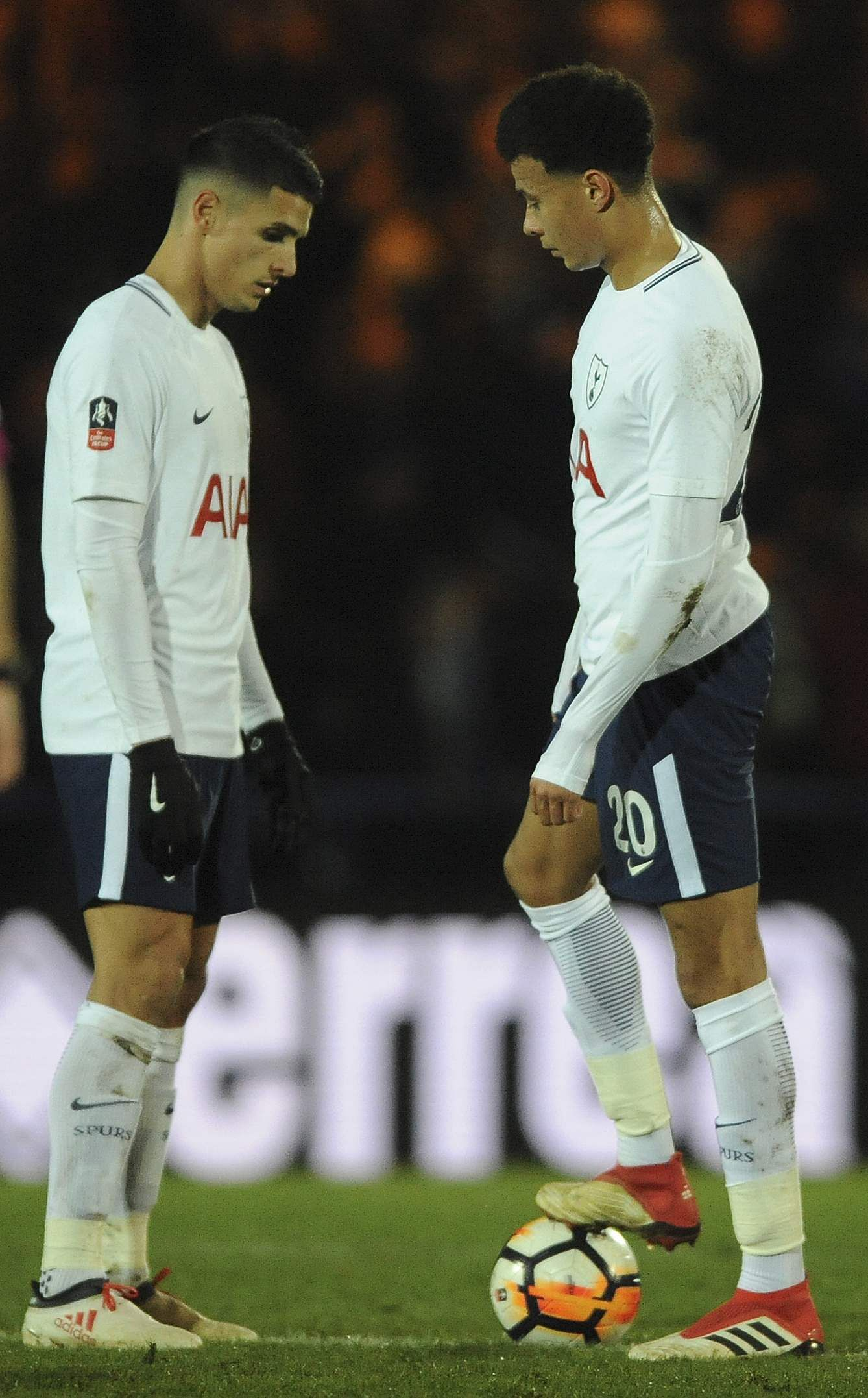 Tottenham's Dele Alli and Tottenham's Erik Lamela react after Rochdale scored the 2-2 during the English FA Cup fifth round match. (AP)