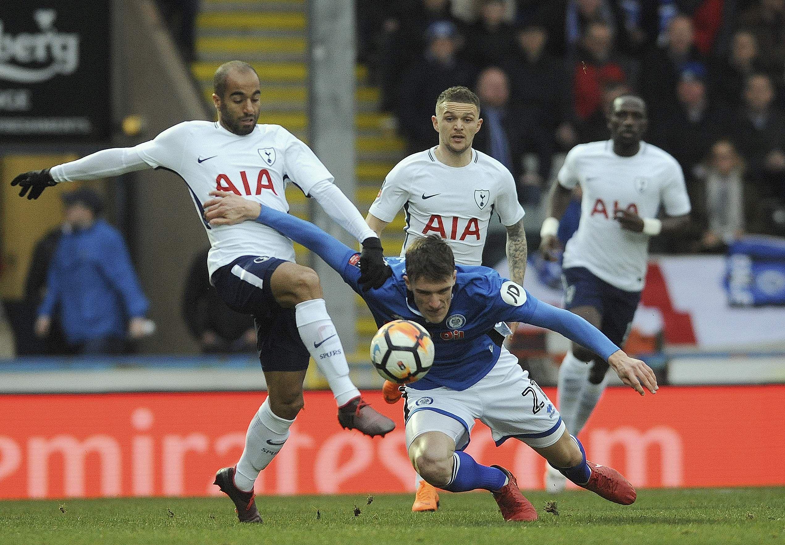 Tottenham's Loucas Moura, left, and Rochdale's Ryan Delaney challenge for the ball. (AP)