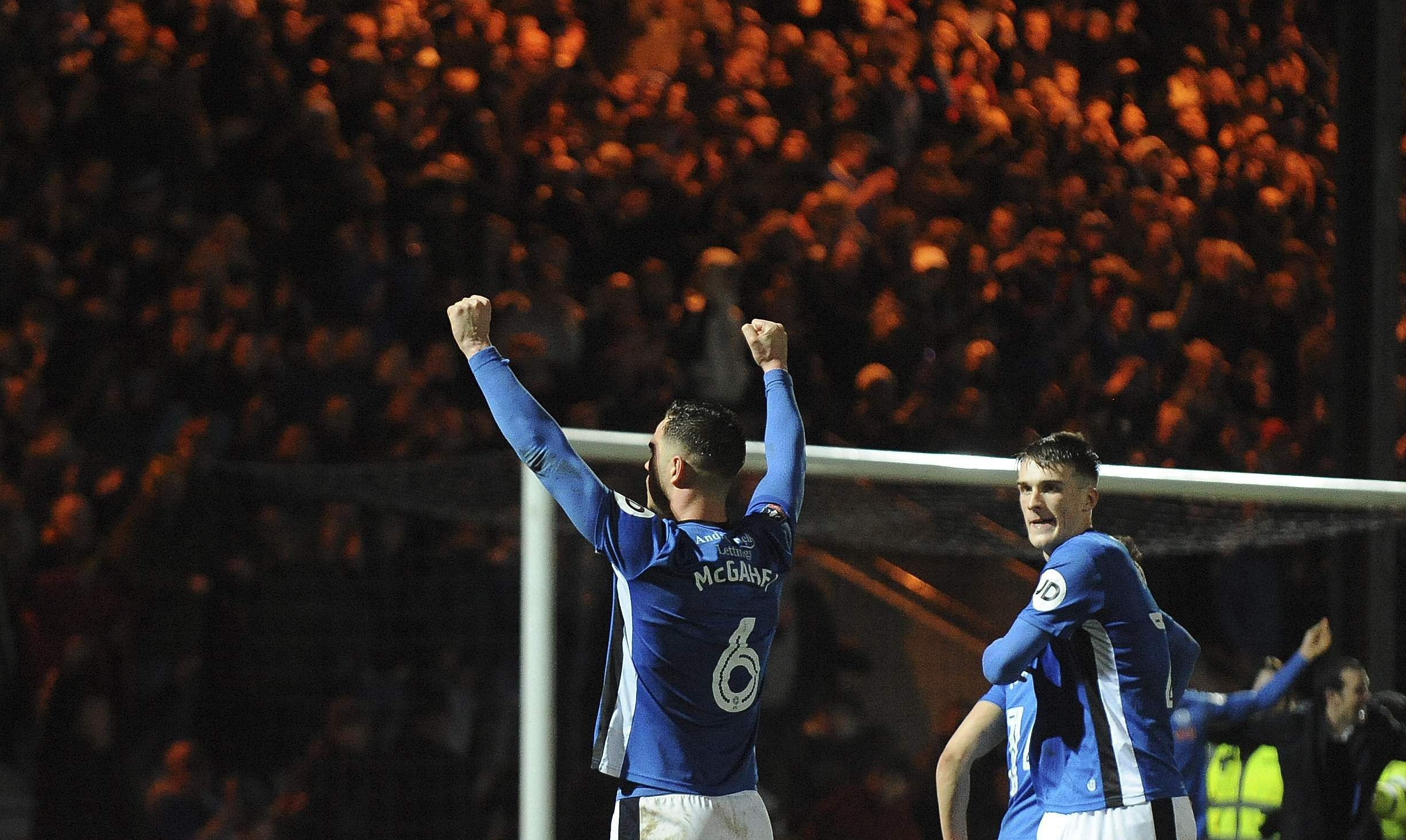 Rochdale players celebrate during the English FA Cup fifth round match between Rochdale AFC and Tottenham Hotspur at the Crown Oil Arena. (AP)