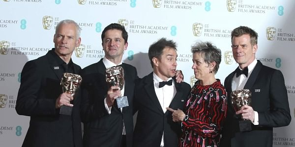 Director Martin McDonagh, from left, producer Peter Czernin, actors Sam Rockwell, Frances McDormand and producer Graham Broadbent pose for photographers backstage with their Best Film awards for 'Three Billboards Outside Ebbing, Missouri' at the BAFTA 2018 Awards in London. | AP