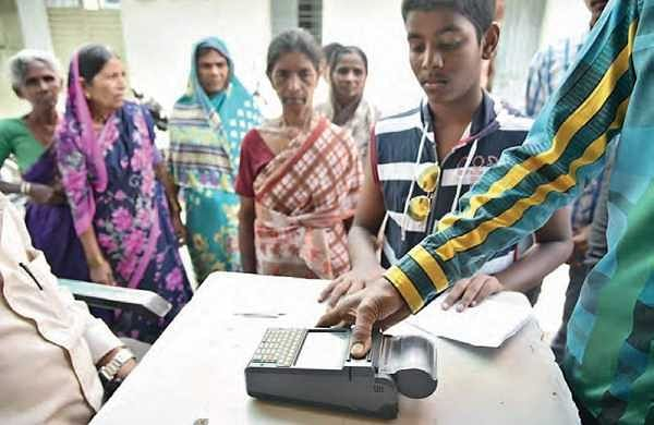 Beneficiaries using bio-metric system at a ration shop in Hyderabad on Sunday   r satish babu