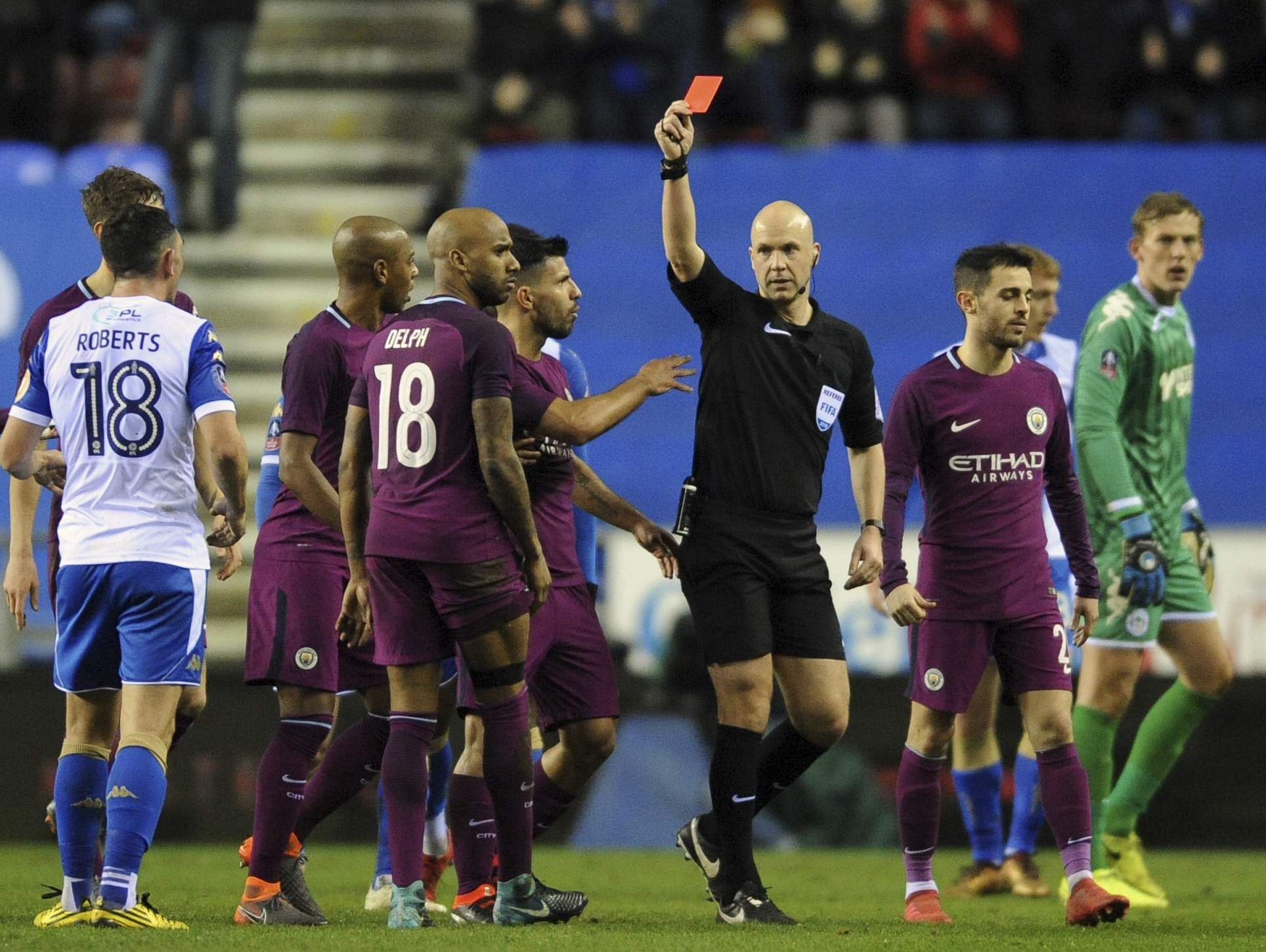 Referee Anthony Taylor shows a red card to Manchester City's Fabian Delph, 18, during the English FA Cup match between Wigan Athletic and Manchester City. (AP)