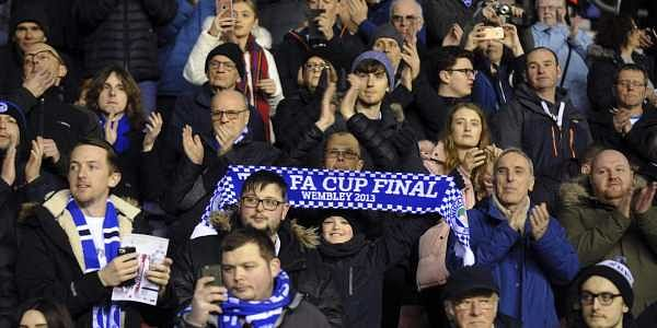 Wigan Athletic fans support their team prior to the English FA Cup fifth round match between Wigan Athletic and Manchester City at The DW Stadium in Wigan, England. (AP)